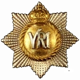 RCR cap badge, 1894 Guelphic crown pattern